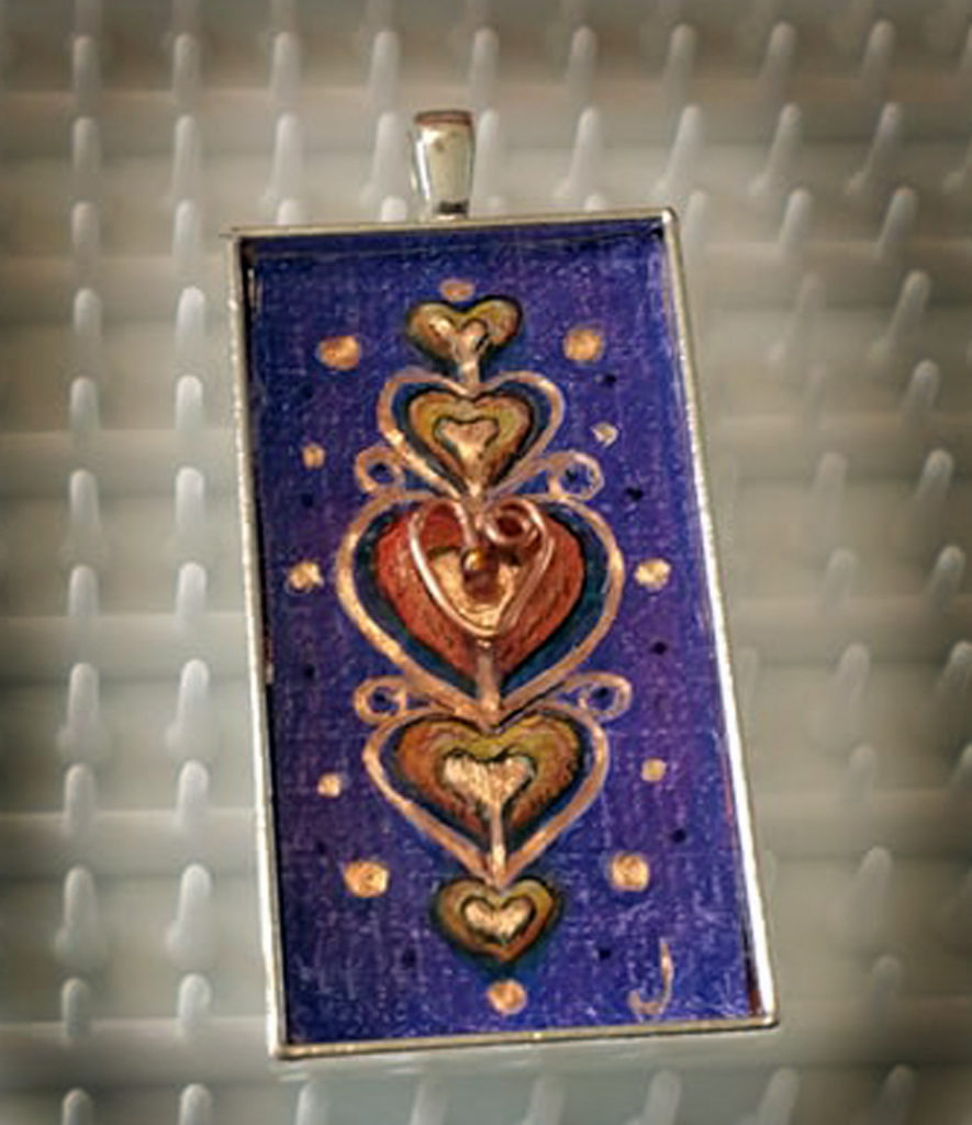 "2""x1"" colored pencil on copper - set in silver pendant bezel and sealed in resin"