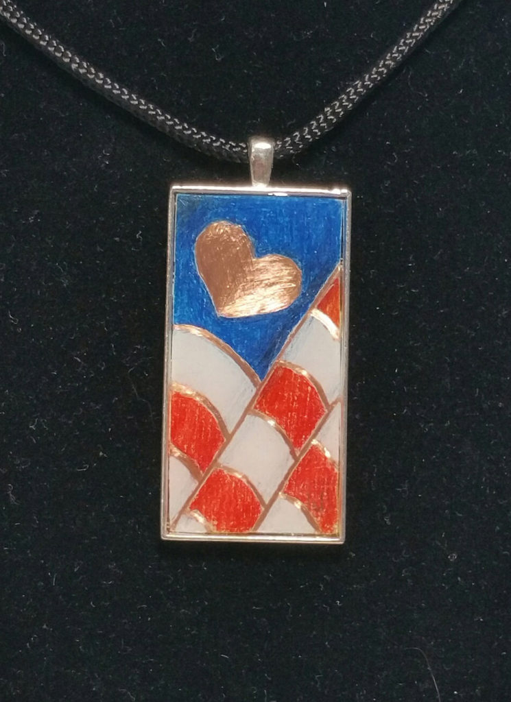 "2""x1"" colored pencil on copper - set in silver pendant bezel."