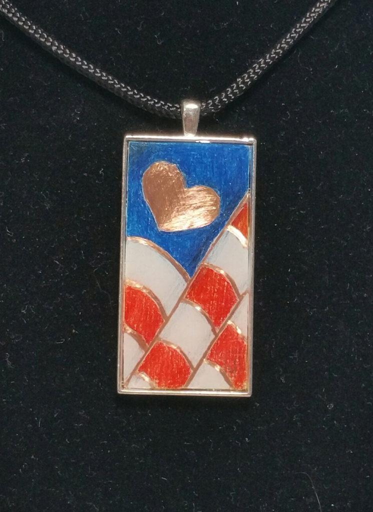 "2""x1"" colored pencil on copper - set in silver pendant bezel."