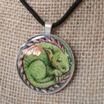 "2"" Colored pencil on copper - set in silver pendant bezel and sealed in resin."