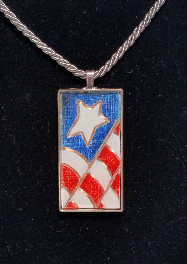 "2""x1"" colored pencil on copper - set in silver pendant bezel and sealed in resin."